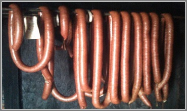 Sausage on Rack in Smokehouse